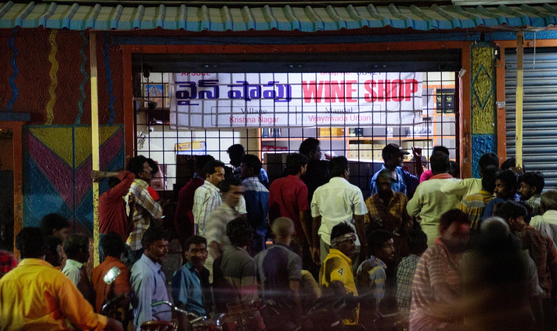 The remaining wine shops in Vijayawada draw jostling crowds every night. Photo by Justin Nisly.