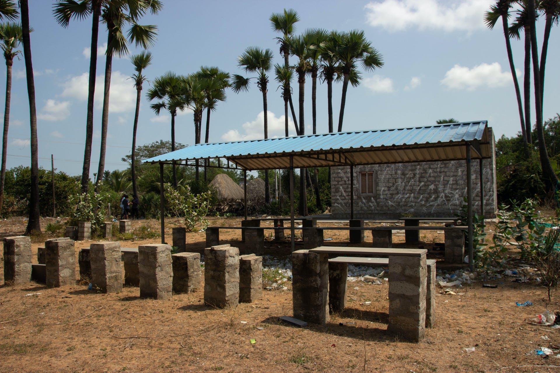 Abandoned benches and bottles mark the site of a shuttered liquor store in Kappaladoddi. Photo by Justin Nisly.