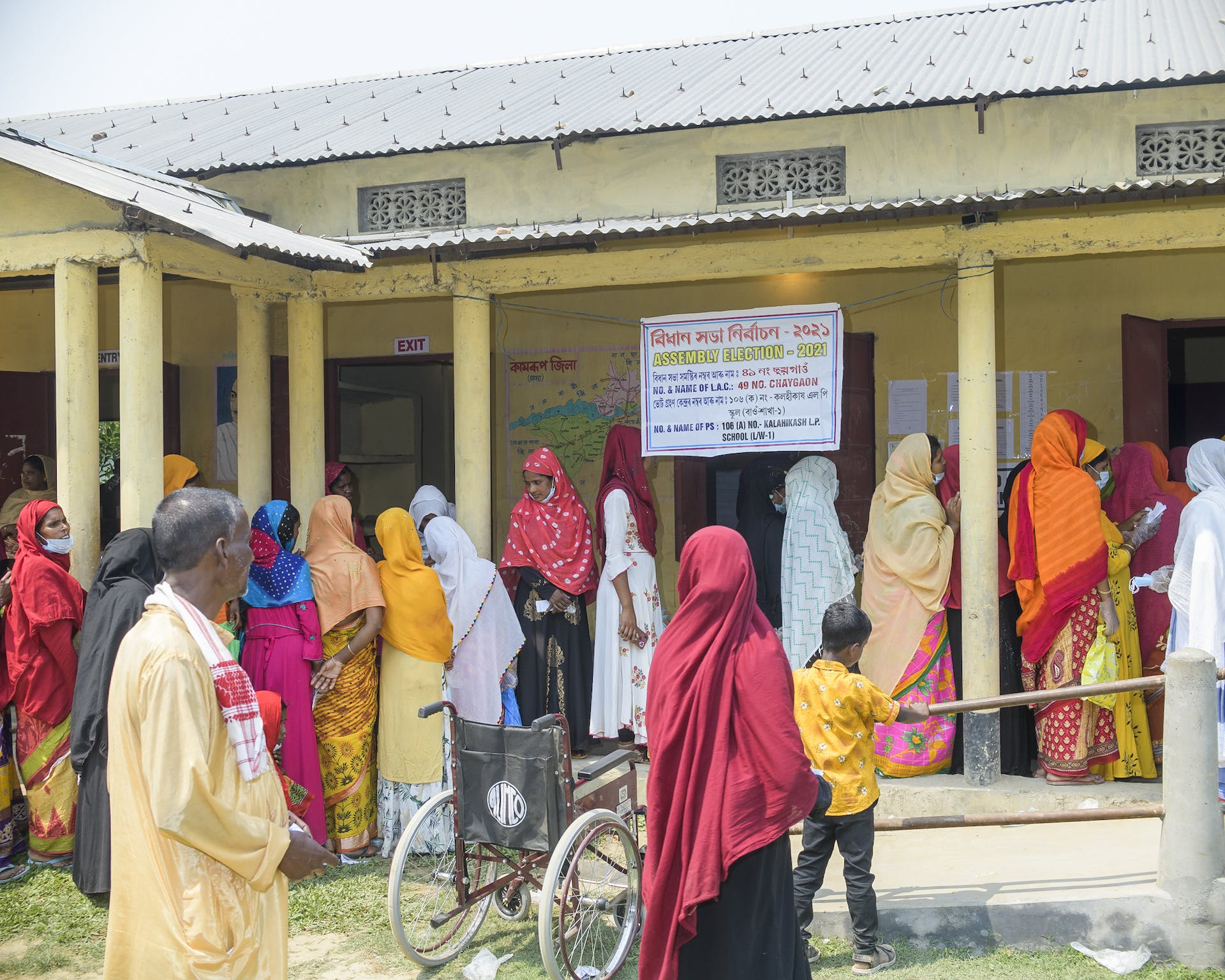 Women line up at the lower primary school in Kalahikash to vote in the assembly election, earlier this year. Picture credit: Prakash Bhuyan.