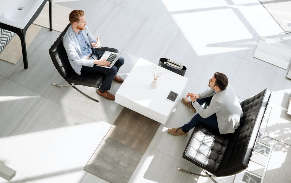 Two people in a meeting