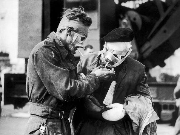 Injured soldiers smoking in Normandy, D-Day, 1944.