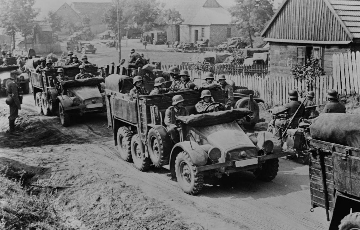 A black and white photograph of soldiers in tanks.