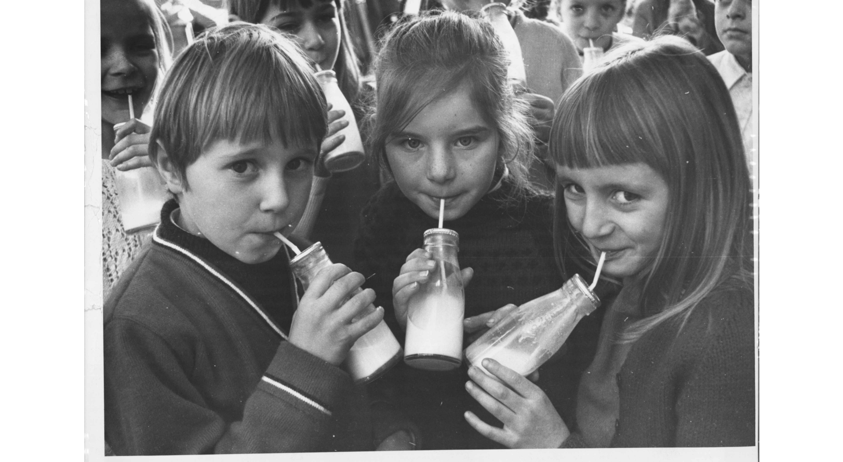 Old school photo of children drinking milk
