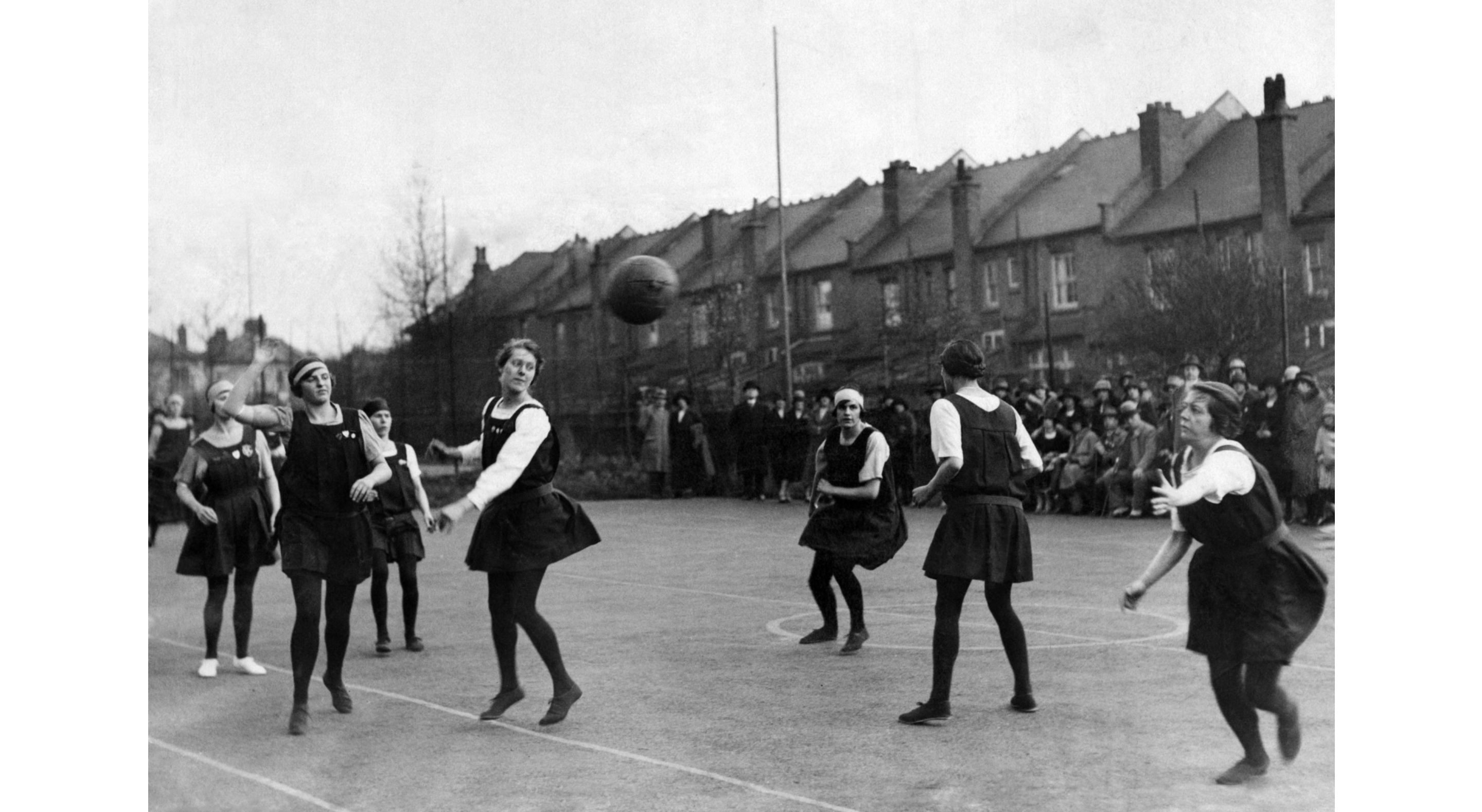 Old photo of girls playing netball