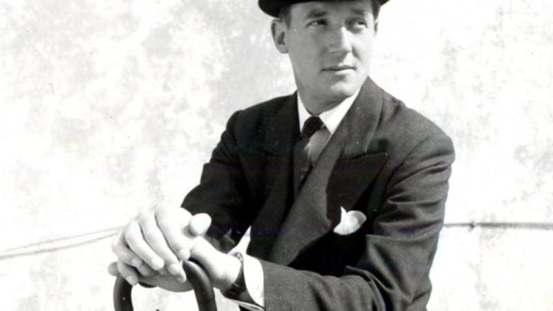 Back and white photo of fashion designer Hardy Amies in a bowler hat.