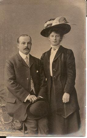 Most Victorian and Edwardian photos are professional studio portraits and usually they were taken to mark a special occasion. The pose of this couple and the display of the lady's ring indicate a wedding photo, her smart suit and hat style typical of c.1910.