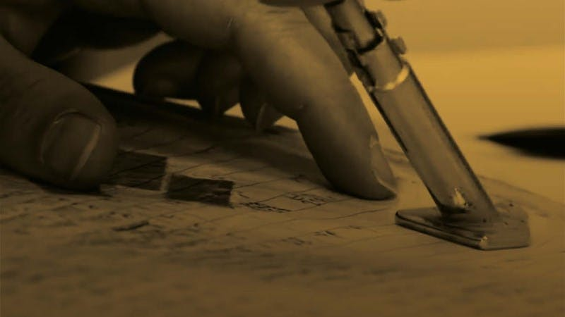 Photo of the hand of someone examining the 1939 register