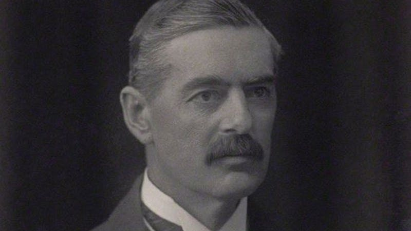 A black and white photograph of Neville Chamberlain.