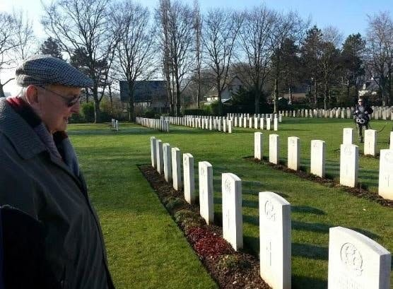 Ray paying his respects at Bayeux cemetery