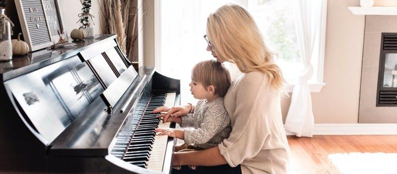 Piano teacher and small child