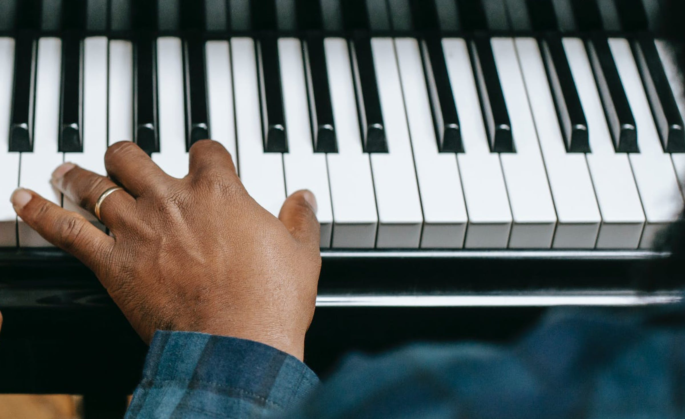 Left hand on a piano