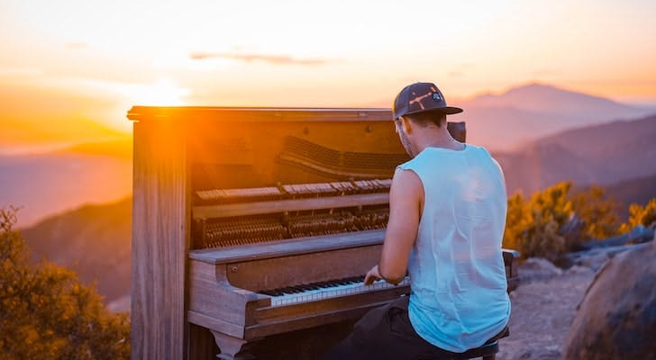 Piano in front of a sunset
