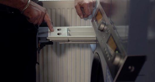 Forbes Professional Inspecting Commercial Washing Machine