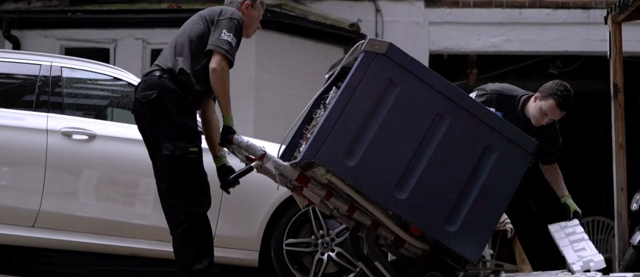 Forbes Professional Engineer Taking Miele Commercial Washer Off of Van
