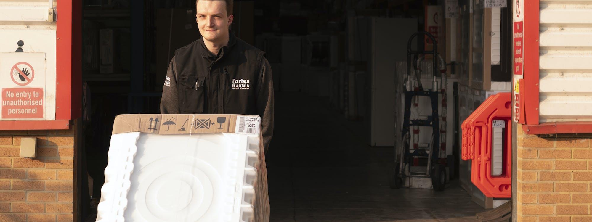 Forbes Professional Warehouse Employee Pushing Washing Machine