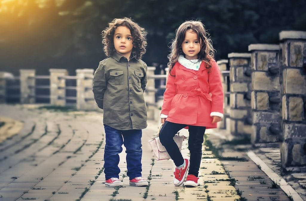 Two children walking on a path
