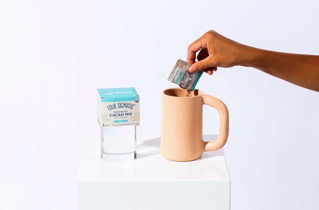 Reishi cacao pouring into mug