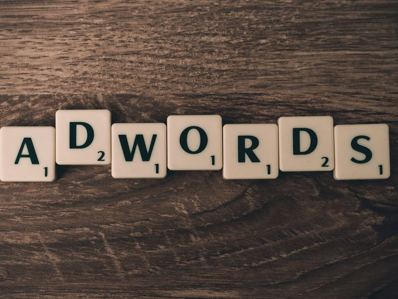 Scrabble tiles arranged to spell 'AdWords'