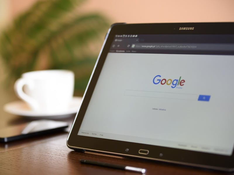 A tablet computer opened to a browser tab displaying Google.