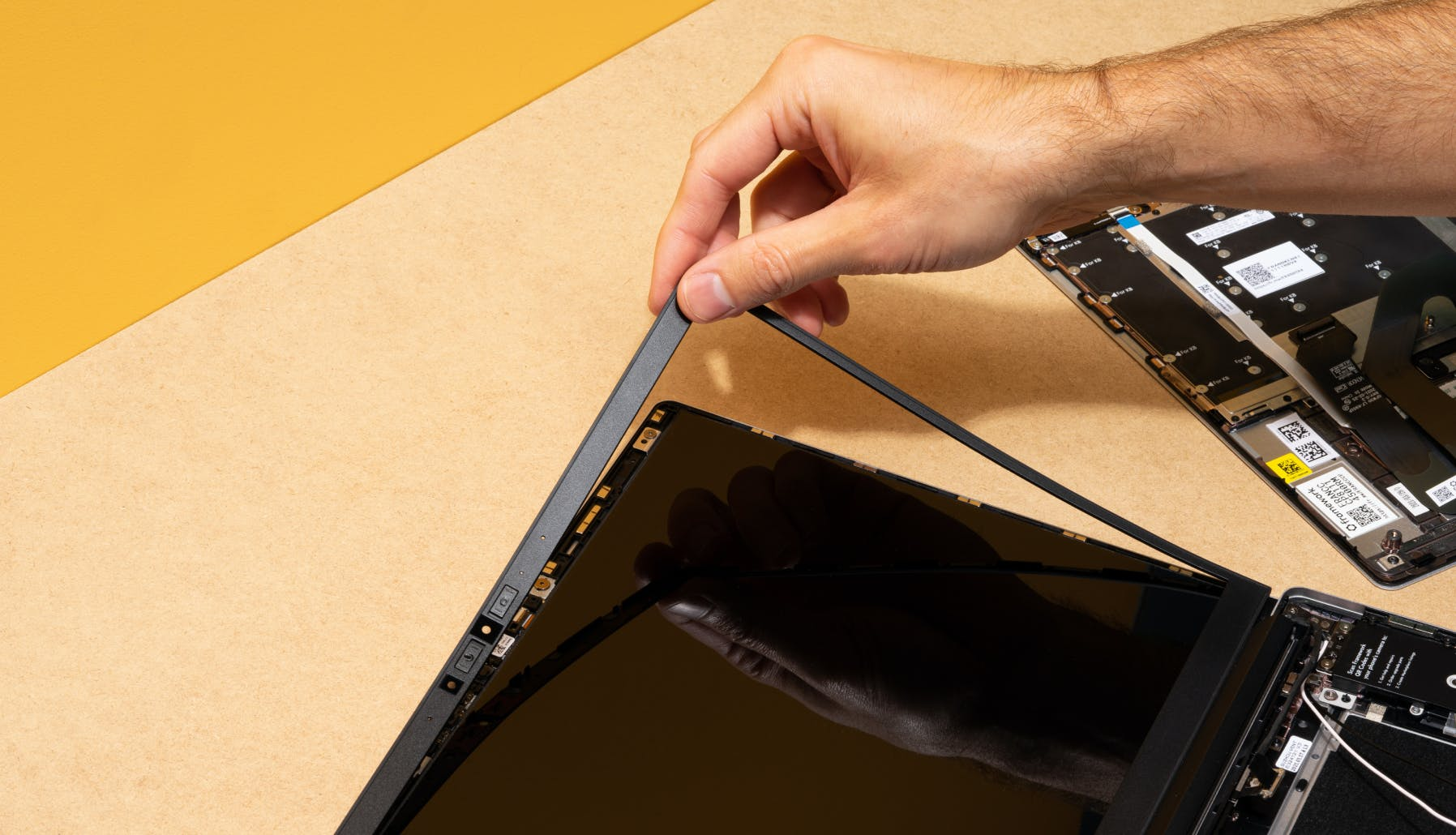 removing a black bezel from the laptop