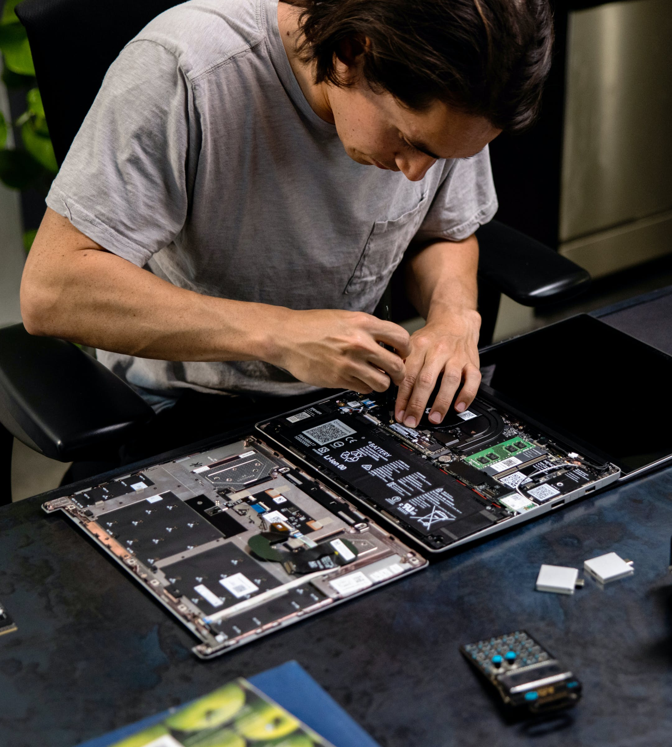 a person assembling a laptop