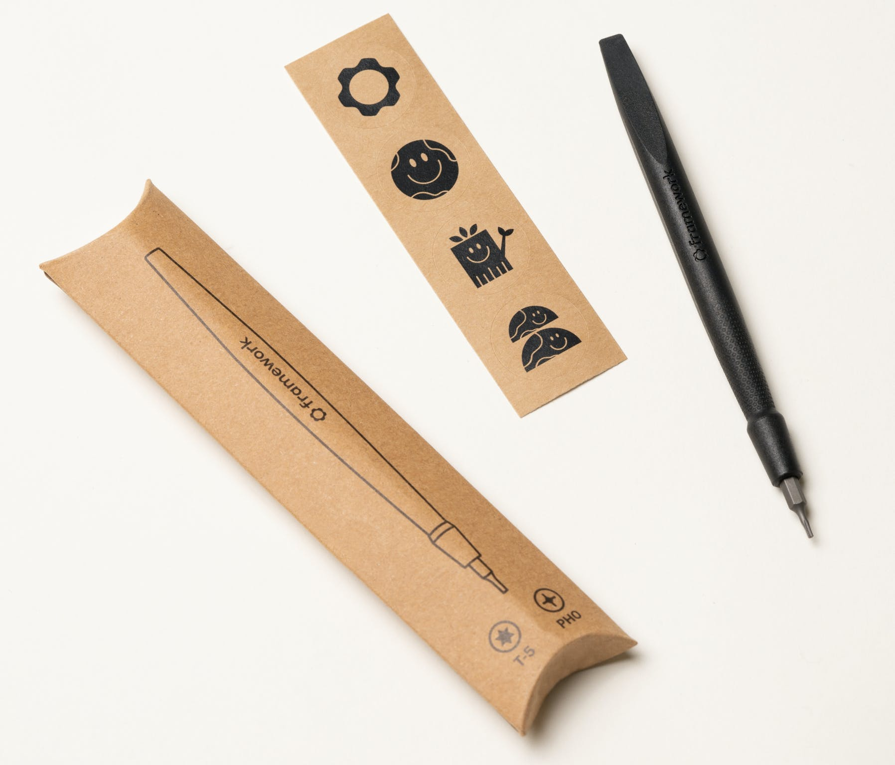 Framework screwdriver with packaging and sticker sheet