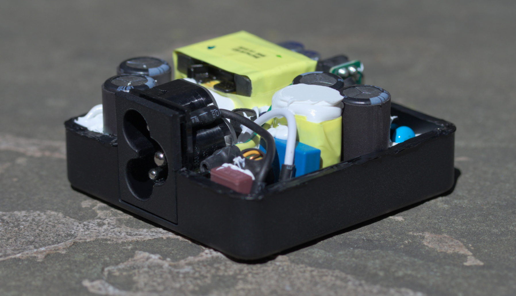 Power adapter with exposed internals