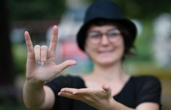 Young woman using sign language.