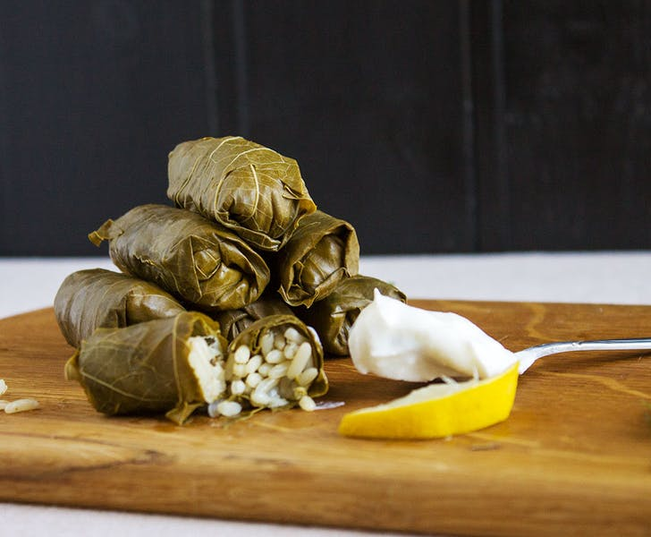 Dolmades are traditional grape leaves stuffed with rice