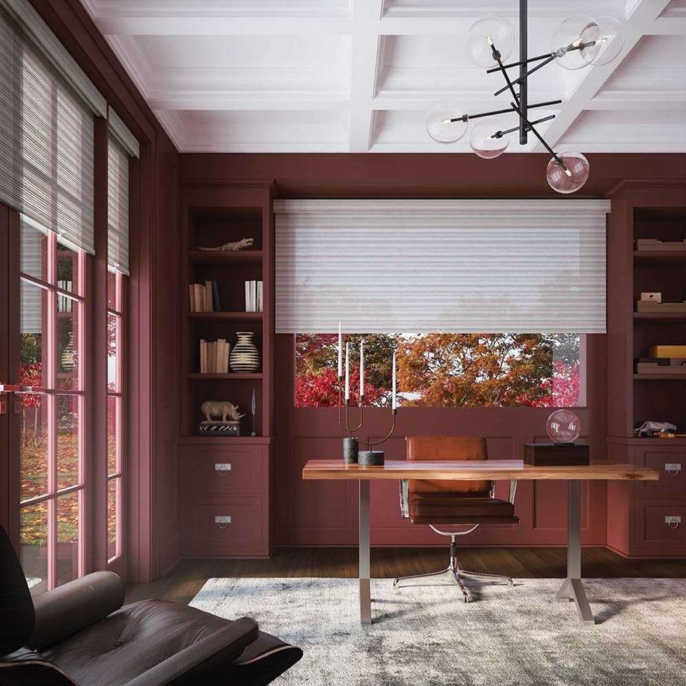 home office and desk with red walls and white window treatments
