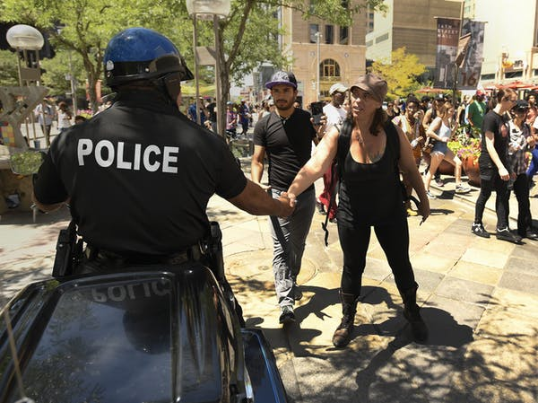 Photo of Police Officer Shaking Hands with Person.