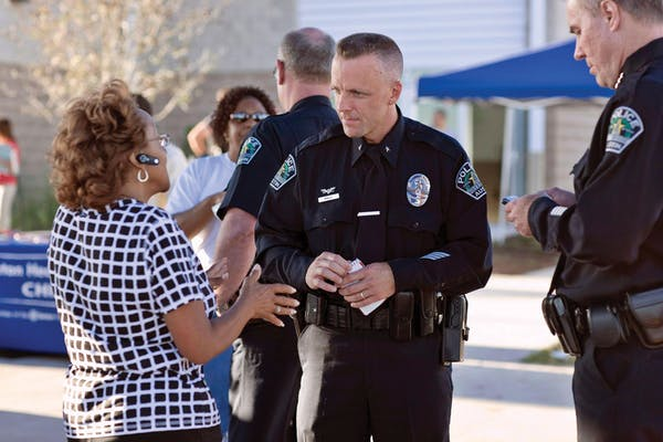 Photo of police officer talking with citizen.