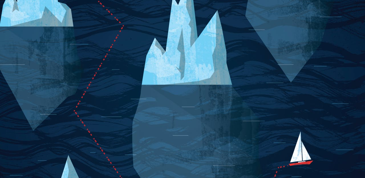 Image of boat and iceberg.