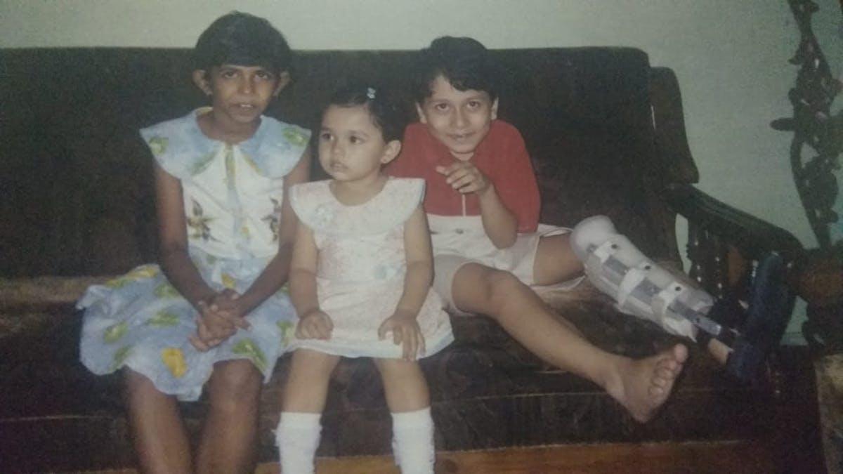 3 kids on a sofa