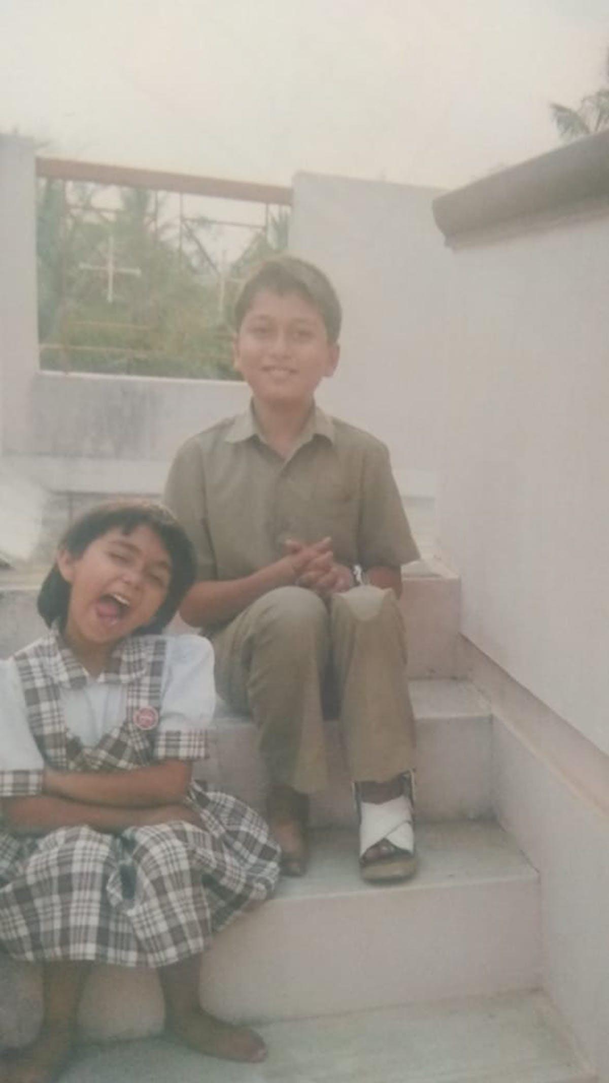 Two kids in school uniforms