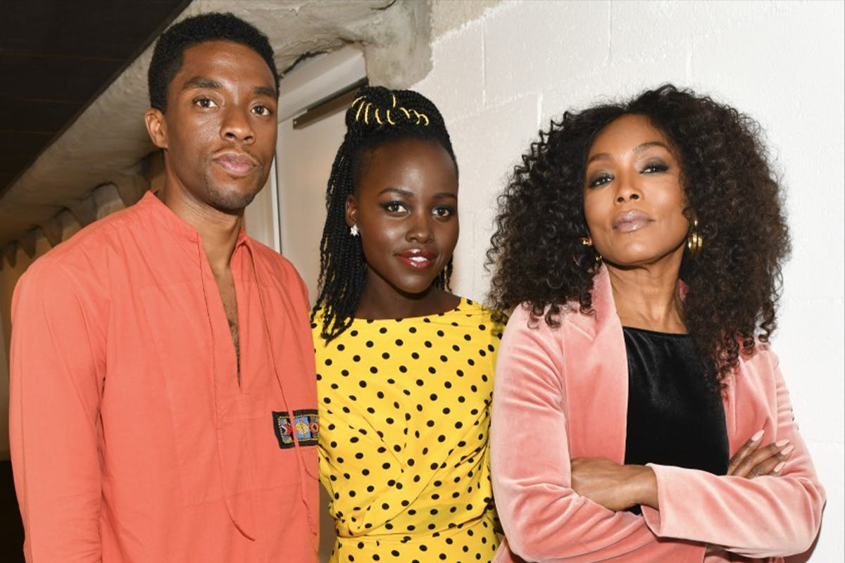 """Chadwick Boseman, left, Lupita Nyong'o and Angela Bassett at a """"Black Panther"""" screening and Q&A at the Hammer Museum in 2018.(Rodin Eckenroth/Getty Images)"""