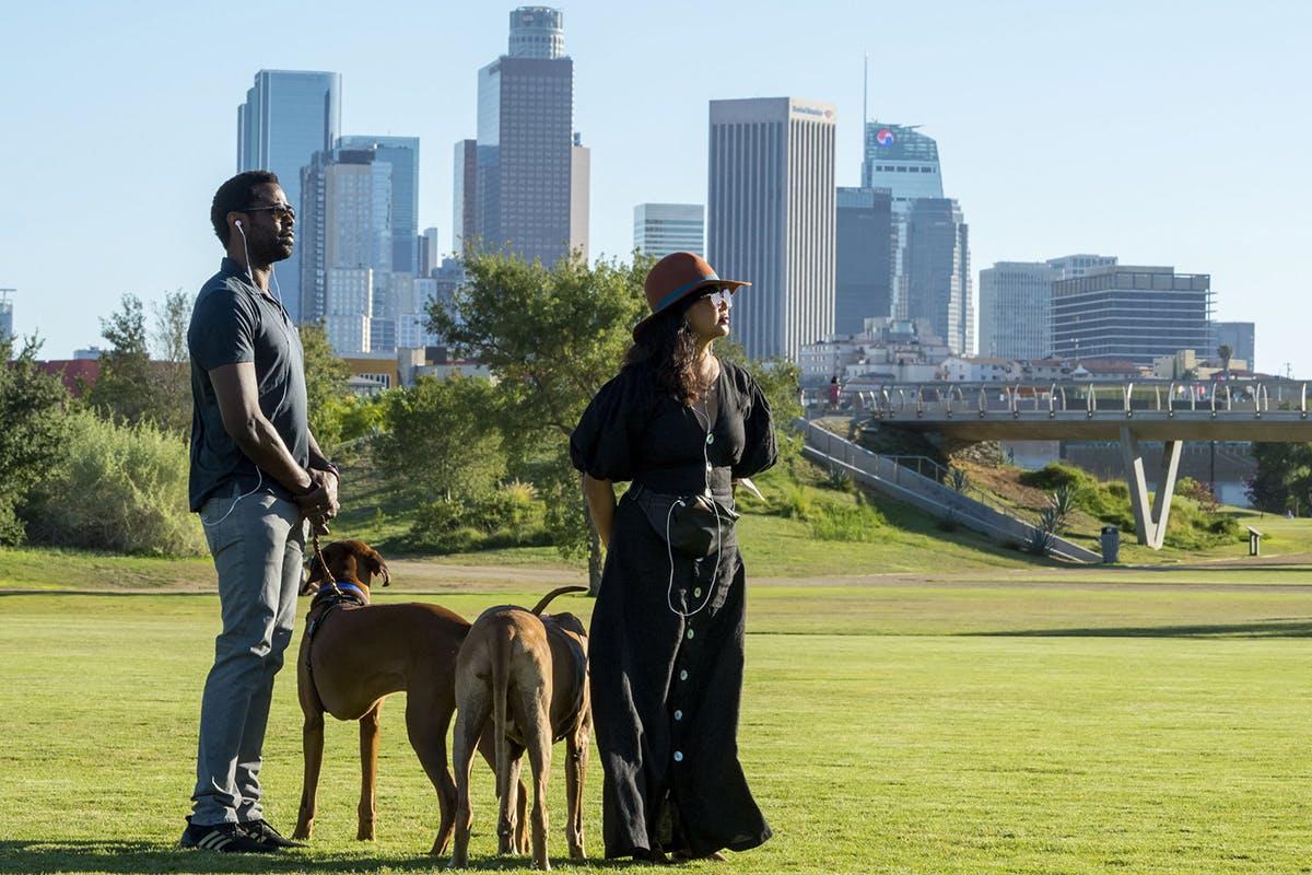 "Brandon Scott and Jenn Liu participate in ""32 Acres,"" a site site-specific soundwalk at Los Angeles State Historic Park."