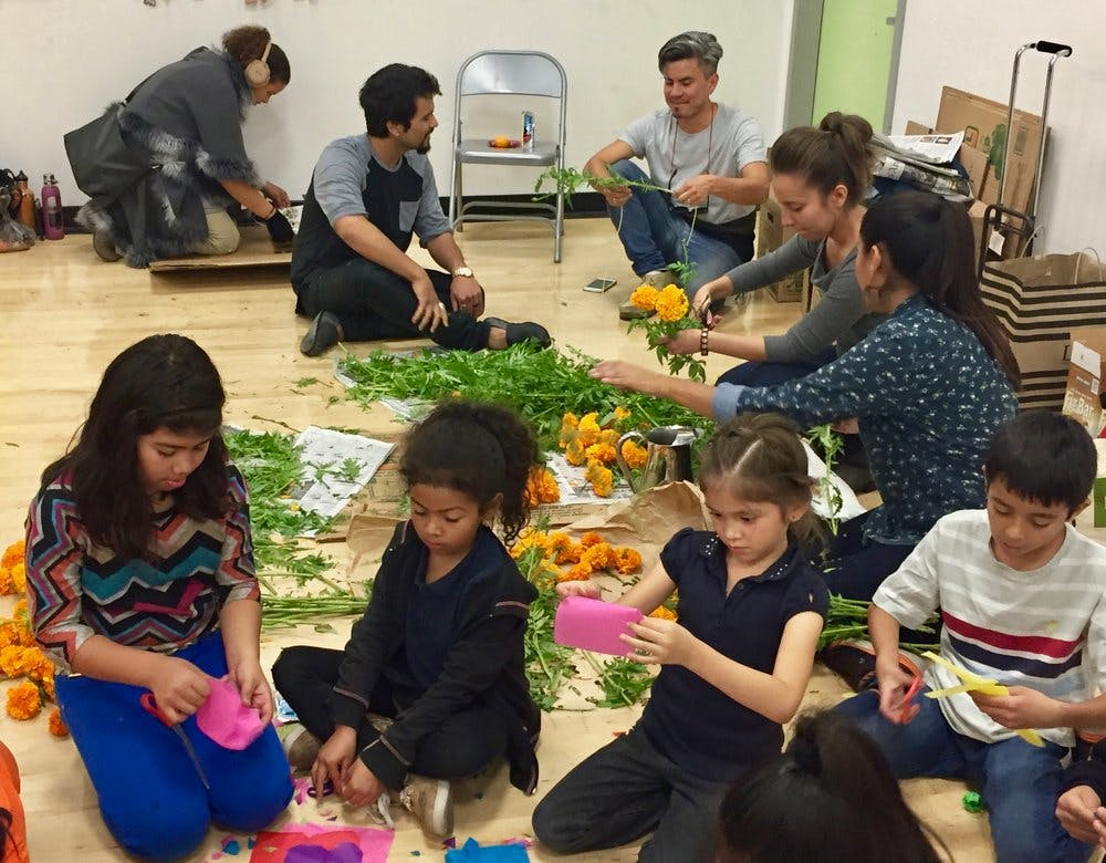 A group of children creating flower decorations.