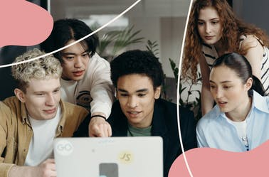 A group of people looking at a laptop screen
