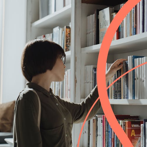 Woman choosing books in a library