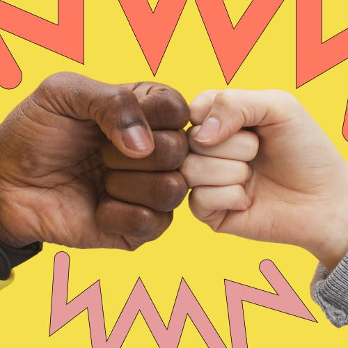 Two hands fist bumping