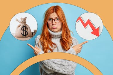 Woman looking sad pointing to a bag of money and a declining arrow