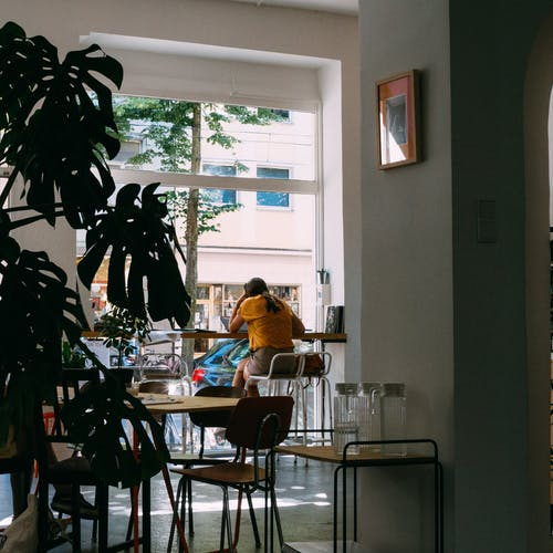 Woman reading alone in a cafe