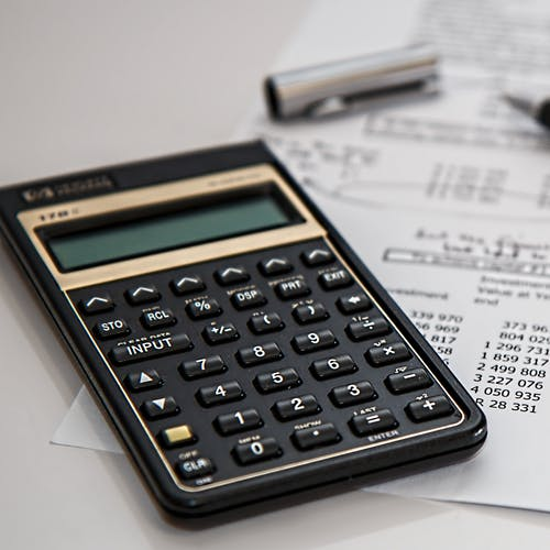 Calculator, pen, and other budgetary equipment