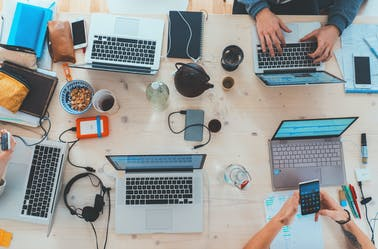 Laptops and smartphones on an office table