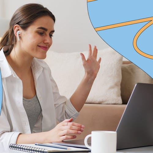 Woman on a call waving at laptop screen