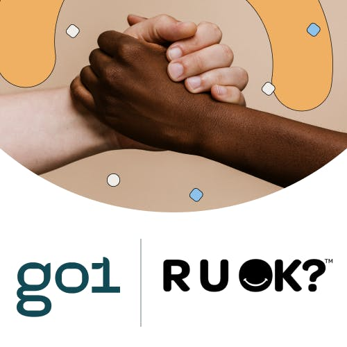 Two hands clasped above Go1 and R U OK? logos