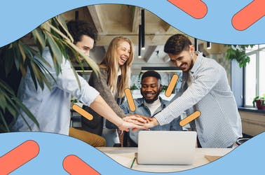 Happy and productive team gather around laptop