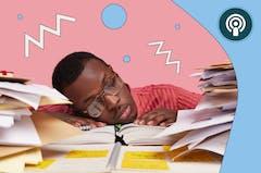 Man falling asleep with head on desk