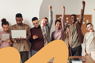 A group of people celebrating in an office